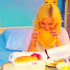 aberration: Leslie from Parks and Rec in a hospital bed and munching on a waffle. (work is third)