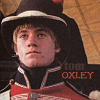 sharpiefan: Close-up of young AoS Royal Marine, text 'Tom Oxley' (Oxley)