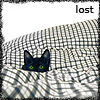khana: black cat in patterend bed sheets: lost (Katze - lost)