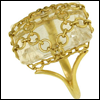 skywardprodigal: gold ring with clear white-ish stone with gold mesh over the stone (bling-warisnetted)