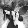 originalpuck: B&W image of a woman with tattoos and fairy wings. (fairywoman)