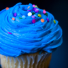 azurelunatic: Blue-iced cupcake with sprinkles.  (cupcake)