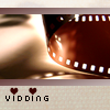 "vidrecs: A strip of film with two small hearts at the bottom, and the text ""Vidding"" (vidding)"