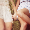 bachelorette: girls holding hands next to each other in the grass (together forever, every reason for every day, bff)
