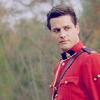 peoriapeoriawhereart: in red serge Benton looks askance (Default)