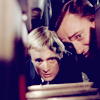 peoriapeoriawhereart: blond and brunet men peer intently (Napoleon & Illya peer)