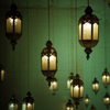 kiyala: lanterns hanging with a green background (STOCK - lanterns)