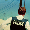 """skieswideopen: A back view of Detective Charlie Crews in a blue kevlar vest labelled """"police"""" (Life: Police)"""