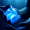 musyc: Person holding a glass jar filled with brilliant blue light (Stock: Blue jar)
