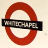 whitechapel: photo of an Underground sign for Whitechapel (the titular neighborhood)