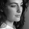 bookblather: Ayelet Zurer looking camera right with a sad smile on her face in black and white. (in the heart : arelie koch : ayelet zure)