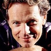 bookblather: Bruce Greenwood resting his chin on his folded hands and smiling. (in the heart : nathan : bruce greenwood)