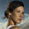 bookblather: Evangeline Lilly with her hair in a bun, looking camera right distantly. (in the heart : melanie : evangeline lill)