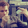 "bookblather: David Tennant messing with a necklace; text is ""Genius at work."" (messing around)"