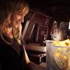 shopfront: Source: Leverage. Parker smiling a wastepaper basket of burning paper. (Lev - [Parker] fun like burning!)