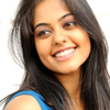 bookblather: Bindu Madhavi in a blue shirt, smiling off-camera. (in the heart : maya : bindu madhavi)