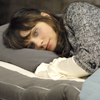 bookblather: Zooey Deschanel lying on a bed, staring at the camera. (in the heart : kayleigh : zooey deschane)