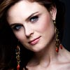 bookblather: Emily Deschanel with long earrings smiling at the camera. (in the heart : paige : emily deschanel)