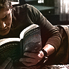 shanaqui: Dean from Supernatural, reading a book. ((Dean) Reading a book)