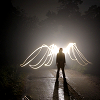 mortalcity: Person silhouetted by wings made of light behind them. (angels | if every angel's terrible...)
