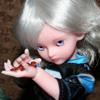 just_lori: Little pink elf doll holding a lizard. (Iggy)
