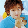 mokarran: Ohno Satoshi, holding a puppy, making a ridiculous face. (arashi: ohno can haz puppy?)