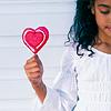 busaikko: a girl on the beach with a heart-shaped lollipop (x heart lollipop)