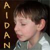 felicula: My son Aidan, a young boy intent on reading. (Aidan)
