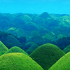 cityofthehand: A landscape picture of bright green hills (Default)