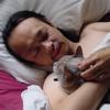 thorfinn: Thorfi in bed cuddling Anakin (a blue burmese cat) (kitten-in-bed)