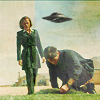 spookyawardsarchive: Mulder and Scully with a spaceship hovering (default)