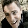 slybrarian: Evan Lorne with a big grin. (Lorne Grin)