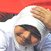 hokuton_punch: A photo of a girl in a headscarf smiling during Ramadan. (ramadan eid-ka-chand smiling girl)