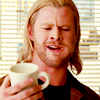 mjolnir_retriever: Thor, with a full mouth, approving of a coffee mug (This drink! I like it!)