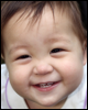 kate_nepveu: infant grinning in closeup (SteelyKid - Hi!! (2009-09))