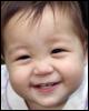 kate_nepveu: infant grinning in closeup (SteelyKid - Hi!! (2009-09))