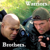 thothmes: Teal'c and Jack lying on the ground talking tactics, legend: Warriors. Brothers. (Warriors - Brothers)