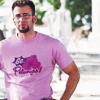 "harpers_child: jake jensen wears a bright pink t-shirt that says ""go petunias!"" (losers: go petunias!)"