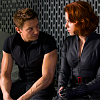 spatz: Clint and Natasha sitting shoulder to shoulder, looking at each other (spy BFFs)