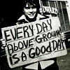 "ar: Emile Hirsch holding a sign reading ""Every day aboveground is a good day."" (misc - every day aboveground)"