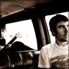 gloss: two men not talking in a van (honey baby)