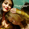 fish_echo: Kaylee and Inara from Firefly hugging, text: huggles (Fandom-Firefly-Kaylee & Inara hugging)