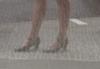 gretacabrel: Snapshot of a woman's legs seen through a screen. (Default)