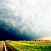 sasha_feather: Road and thunderheads (big sky)