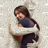 sasha_feather: white woman hugging textual man (books)