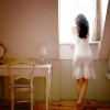 coffeevore: A person in a subdued, closed-in room, looking out a bright sunny window. (looking outward)
