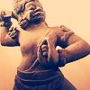 ananzi: (dancing statue)