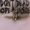 "mortalcity: A barred door with the words ""don't open, dead inside"" painted on (zombies 