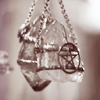 samecgh: A crystal pendant with a pentacle wrapped around (Crystal)