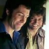sineala: Bodie and Doyle (from Pros) smiling next to a window (bodie/doyle window)